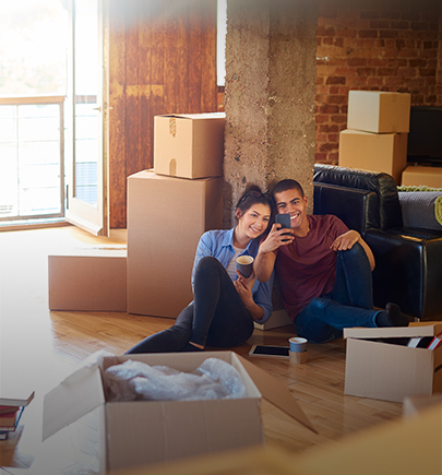 Couple at home with moving boxes