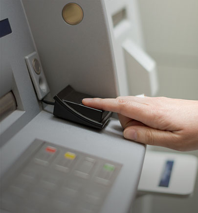 managed security services - person using biometrics ATM