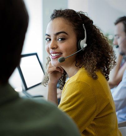 Customer service agent smiling over shoulder